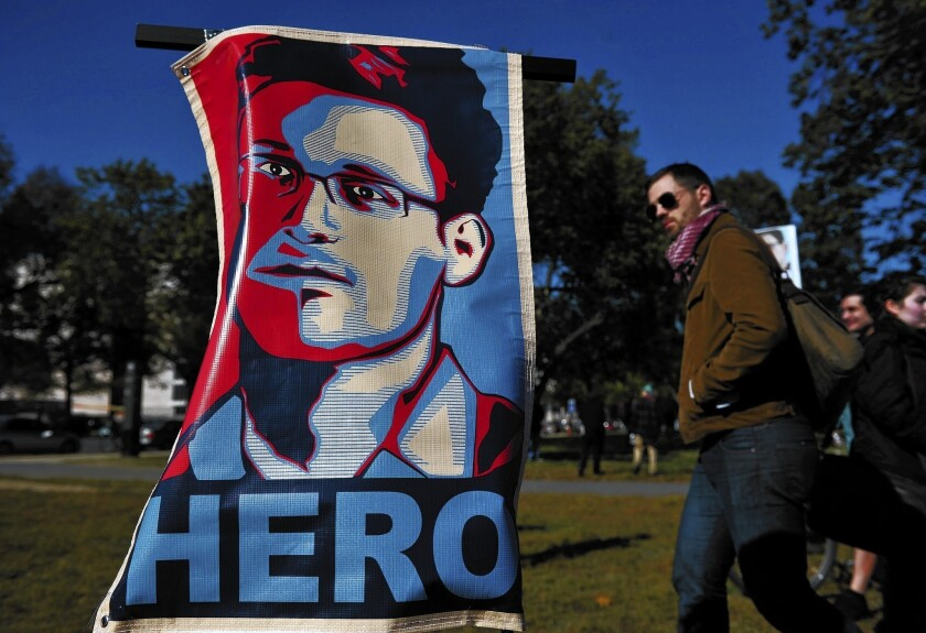 At a protest against government surveillance in Washington in October, a poster of Edward Snowden declares him a hero.