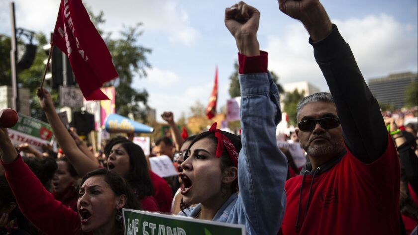 Educators, students and supporters rally on the fifth day of the LAUSD teachers' strike at Grand Park in Los Angeles on Jan. 18.