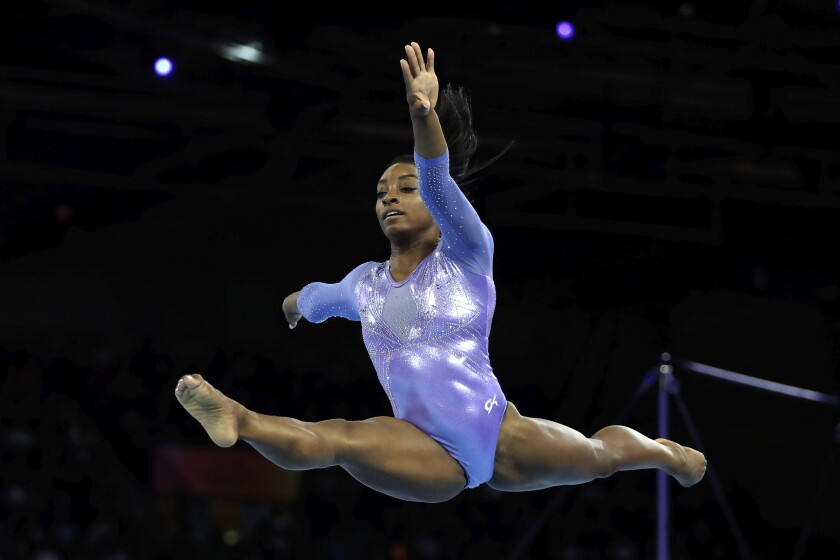 Gold medalist Simone Biles of the United States performs on the floor in the women's apparatus finals at the Gymnastics World Championships in Stuttgart, Germany, on Sunday.