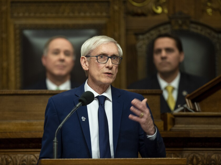 FILE - In this Jan. 22, 2019 file photo, Wisconsin Gov. Tony Evers addresses a joint session of the Legislature in the Assembly chambers during the Governor's State of the State speech at the state Capitol, in Madison, Wis. Behind Evers is Assembly Speaker Robin Vos, R-Rochester, left, and Senate President Roger Roth, R-Appleton. Evers tried for months for the Legislature to take up gun control bills to no avail. So he recently called a special session to force them to convene on the issue. (AP Photo/Andy Manis, File)