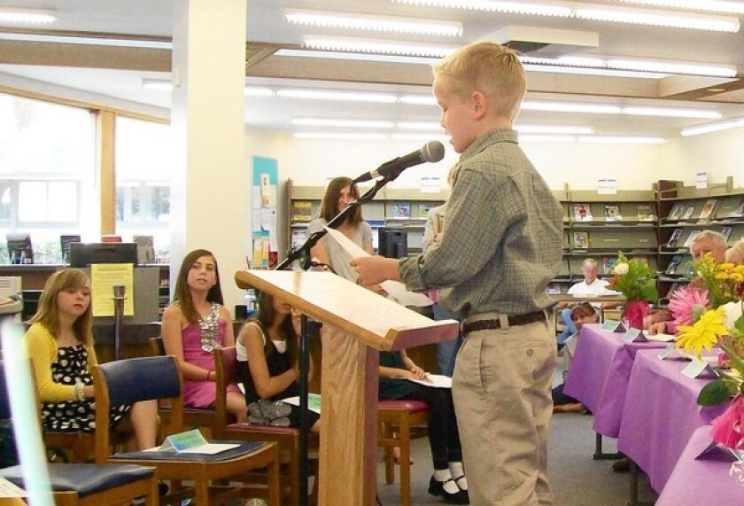 A poetry winner reads his work at the Laguna Beach Library in 2010.