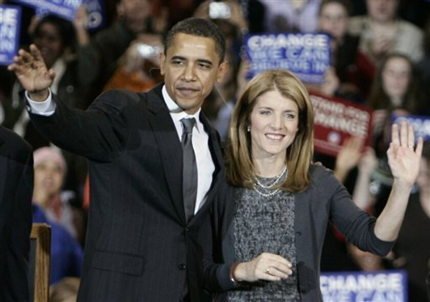 In this Monday, Jan. 28, 2008 file photo, then Democratic presidential hopeful Sen. Barack Obama, D-Ill., waves to supporters with Caroline Kennedy, after she endorsed him during a rally at American University in Washington. Although she was no stranger to politics, much was made of the daughter of