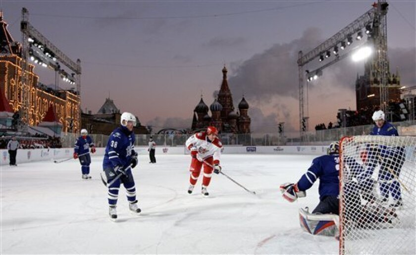 Players from Alexei Yashin Team, in red, and Jaromir Jagr Team, in blue, are seenin action during the KHL All Stars ice hockey match at the Red Square in Moscow, Saturday, Jan. 10, 2009. (AP Photo/Misha Japaridze)