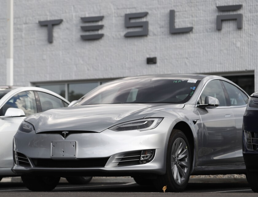 Tesla 2018 Model 3 sedans sitting on display outside a Tesla showroom in Littleton, Colo.