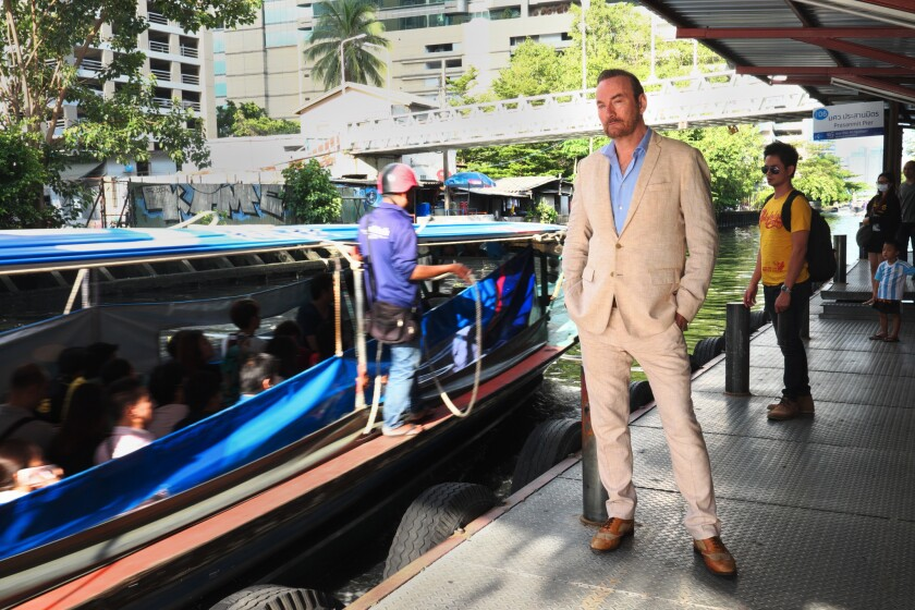 Author Lawrence Osborne standing by the Sang Seab Canal in Bangkok, Thailand. Lawrence Osborne has