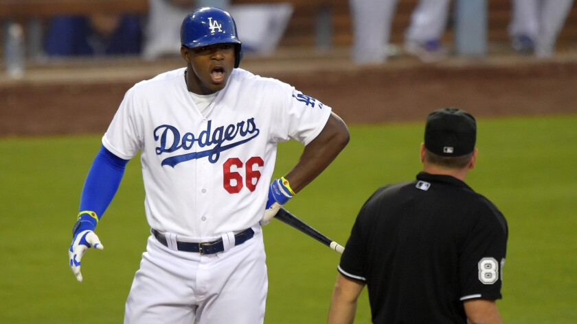Yasiel Puig confronts plate umpire David Rackley after being called for a third strike during the third inning of the Dodgers' 1-0 win over the San Diego Padres at Dodger Stadium on Saturday. Rackley ejected Puig moments later.