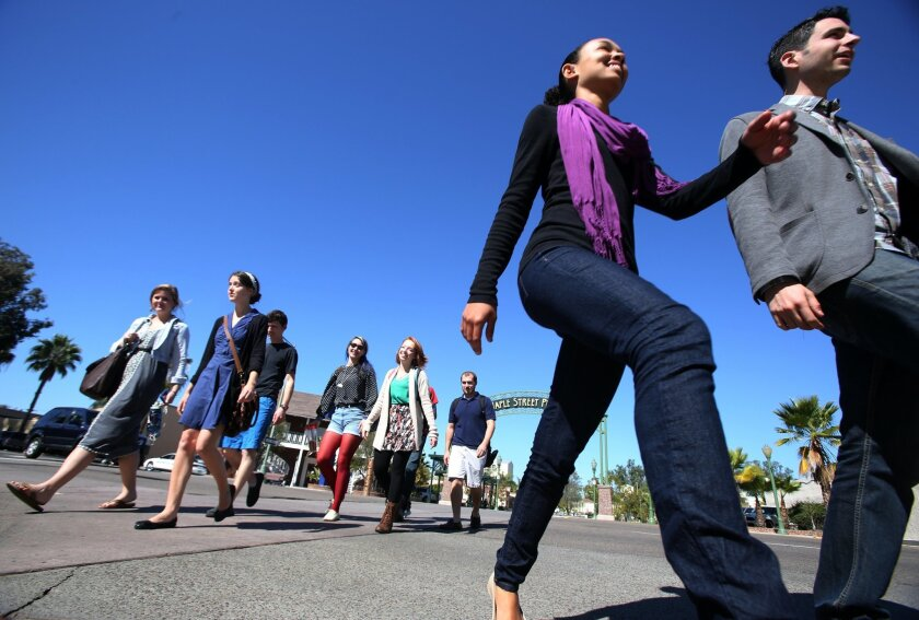 Students at  J.P. Catholic head back to school in downtown Escondido Wednesday.
