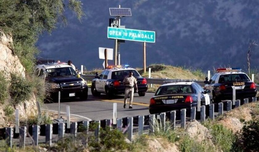 California Highway Patrol officers closed Angeles Crest Highway on Thursday, May 10, after a man's body was discovered near mile marker 27.