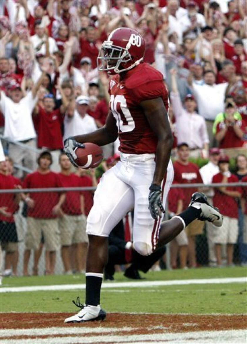 Alabama wide receiver Mike McCoy (80) walks in for a touchdown against Florida International during an NCAA football game on Saturday, Sept. 12, 2009, in Tuscaloosa, Ala. (AP Photo/ Butch Dill)