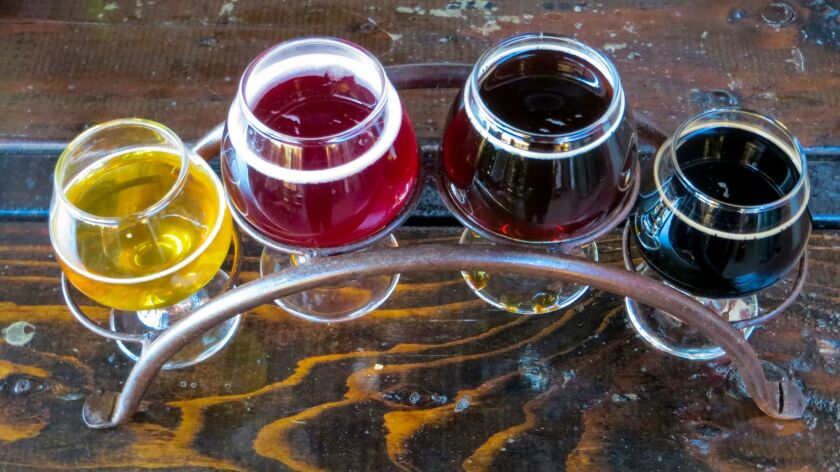 A batch of tasters at Border X Brewing in Barrio Logan, an up-and-coming arts district.
