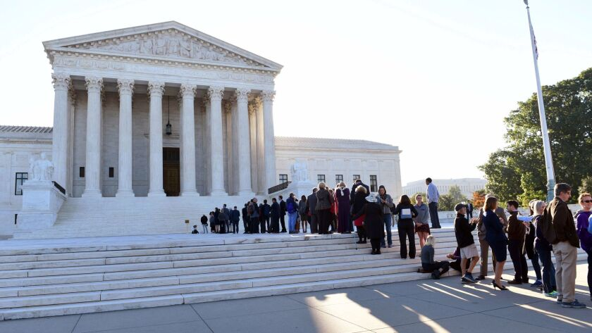 People stand in line to enter the Supreme Court for the first day of the new term in Washington on Oct. 2.