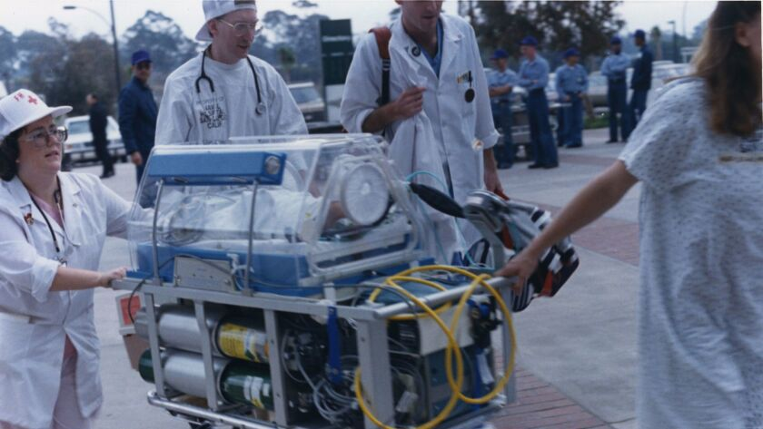 In 1988, Navy hospital workers move patients from the former facility into the new medical center.