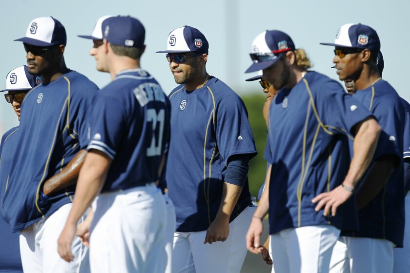 San Diego Padres outfielder Matt Kemp, center, listens to coach Tarrik Brock during a spring training practice.