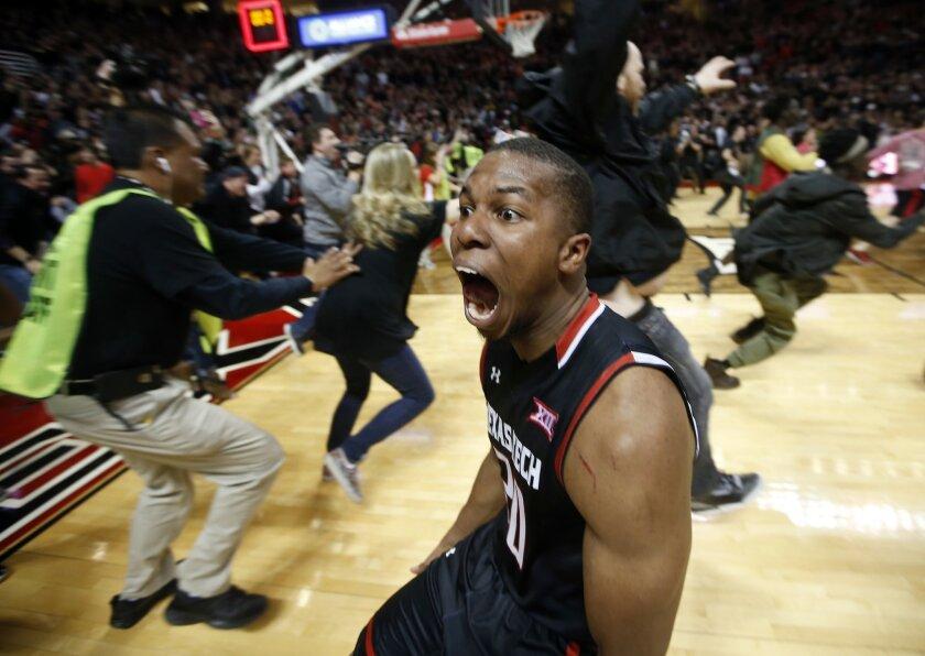 Texas Tech's Toddrick Gotcher runs toward fans to celebrate after an NCAA college basketball game against Oklahoma on Wednesday, Feb. 17, 2016, in Lubbock, Texas. Texas Tech won 65-63. (AP Photo/Brad Tollefson)