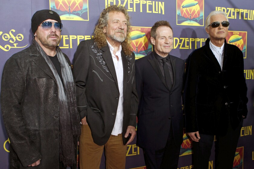 """FILE - This Oct. 9, 2012 file photo shows, from left, Jason Bonham, son of the late Led Zeppelin drummer John Bonham; singer Robert Plant; bassist John Paul Jones; and guitarist Jimmy Page at the """"Led Zeppelin: Celebration Day"""" premiere in New York. Members of an 11-judge panel of the 9th U.S. Circuit Court of Appeals harshly challenged plaintiffs who argued that a new trial in the copyright fight over Led Zeppelin's """"Stairway to Heaven is justified. The lawsuit that alleges 1971's """"Stairway"""" was stolen from 1968's """"Taurus,"""" by Spirit. (Photo by Dario Cantatore/Invision/AP, File)"""