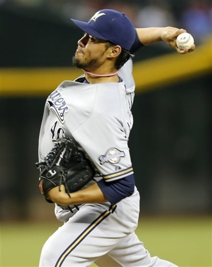 Milwaukee Brewers pitcher Yovani Gallardo delivers against the Arizona Diamondbacks during the first inning of a baseball game on Thursday, July 11, 2013, in Phoenix. (AP Photo/Matt York)
