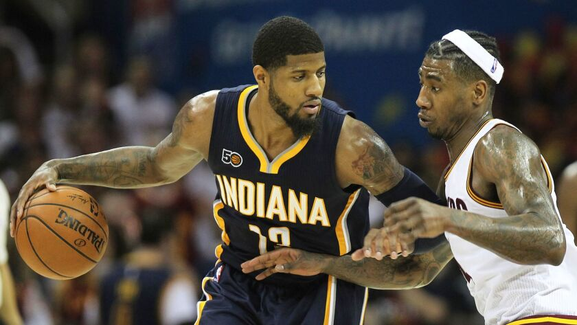 Indiana's Paul George is guarded by Cleveland's Iman Shumpert on April 17.