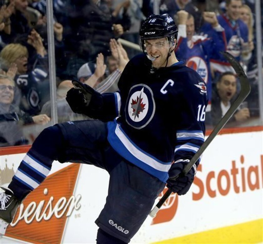 Winnipeg Jets' Andrew Ladd (16) celebrates after scoring against the Tampa Bay Lightning during the second period of their NHL hockey game in Winnipeg, Manitoba, Tuesday, April 16, 2013. (AP Photo/The Canadian Press, Trevor Hagan)
