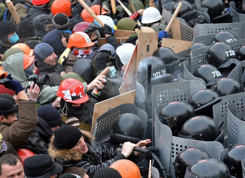 Protesters clash with police during an opposition rally in the center of the Ukrainian capital of Kiev.