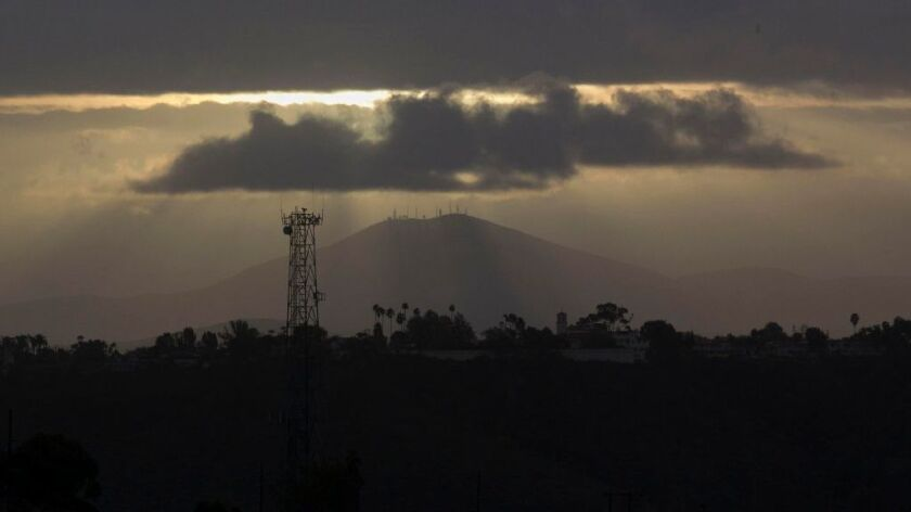 Mount San Miguel appeared to have it's own rain cloud over it early Monday, Jan. 23 as the storm system that has been passing through the county was breaking up.