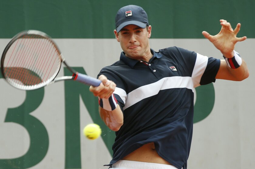 John Isner of the U.S. returns the ball to Russia's Teymuraz Gabashvili during their third round match of the French Open tennis tournament at the Roland Garros stadium, Friday, May 27, 2016 in Paris.  (AP Photo/Alastair Grant)