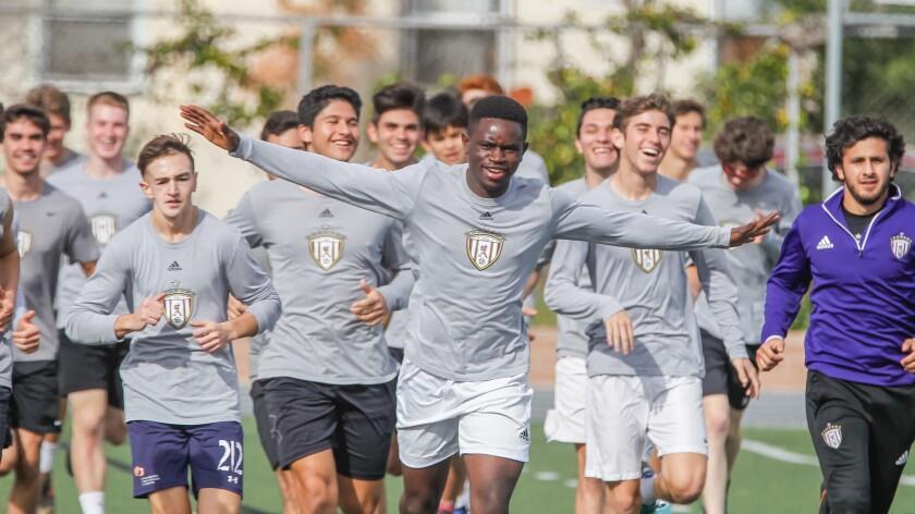 SAN DIEGO, CA February 1st, 2019   St. Augustine boys soccer player Francois Ekyoci (arms up) has a