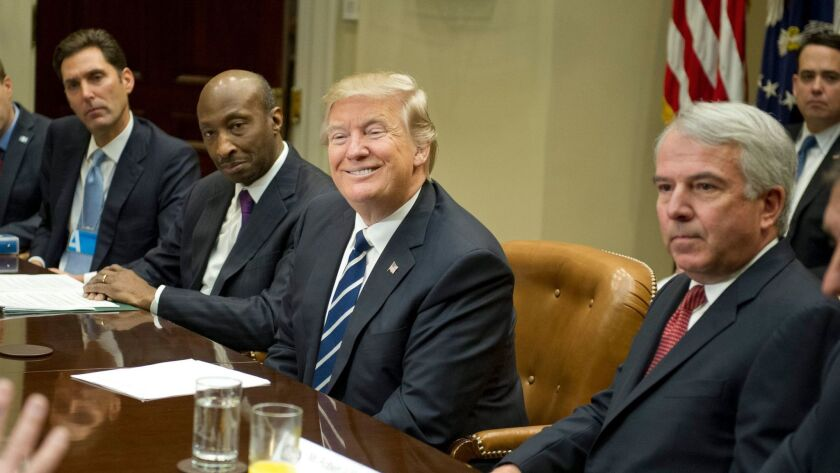 President Trump meets with drug industry bosses Tuesday: (from left) Stephen Ubl, president and CEO, PhARMA; Kenneth C. Frazier, chairman and CEO of Merck & Co; Trump; Robert J. Hugin, executive chairman, Celgene Corp.