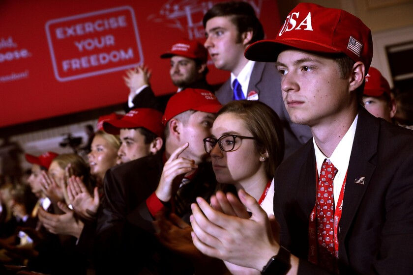 Young supporters cheer as President Donald Trump addresses the Conservative Political Action Conference at the Gaylord National Resort and Convention Center Feb. 23, 2018, in National Harbor, Md.