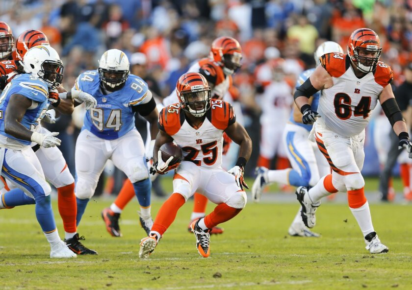 Bengals Giovani Bernard rips off a long run during the Chargers football game against the Cincinnati Bengals at Qualcomm Stadium Sunday.