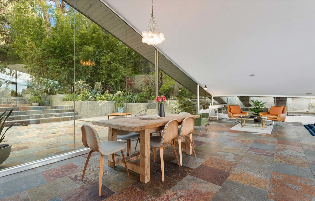 Built by noted architect Harry Gelson, the Midcentury home boasts an expansive open floor plan with triangular glass walls.