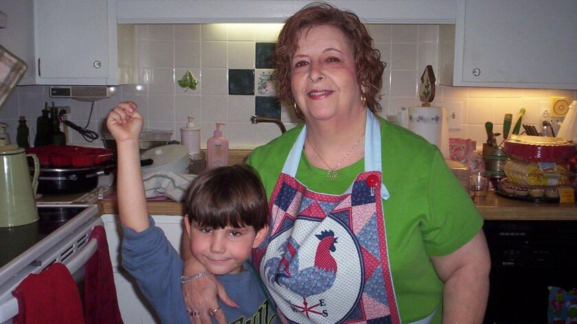 Barbara Barkley with her grandson, making Christmas cookies at the house she lost to a mortgage scam.