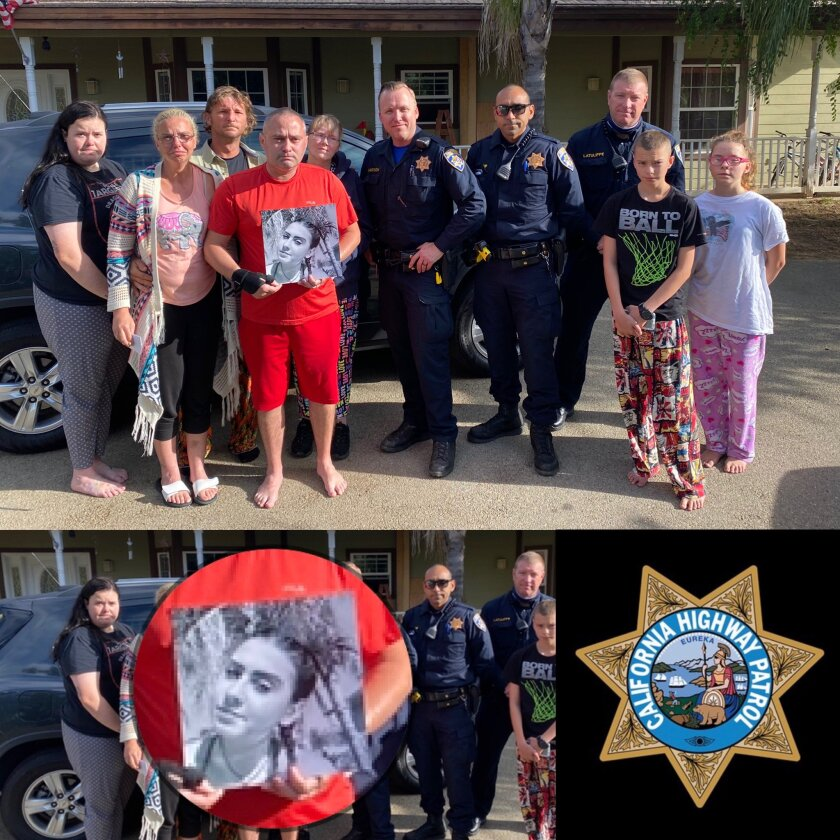 Family members and CHP officers pose with a photo of Kirsten Tomlinson, who died in a June 6 hit-and-run in Escondido.