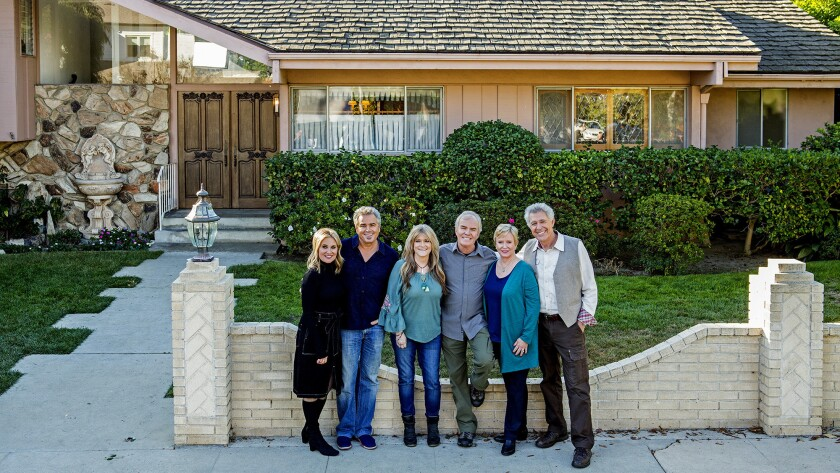"The remaining ""Brady Bunch"" cast members in front of the ""Brady house."""