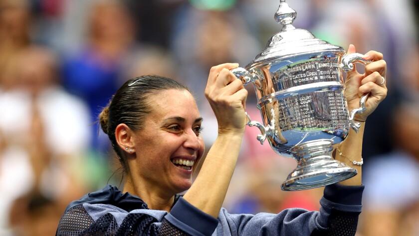 Flavia Pennetta hoists the winner's trophy after defeating fellow Italian Roberta Vinci for the U.S. Open title.