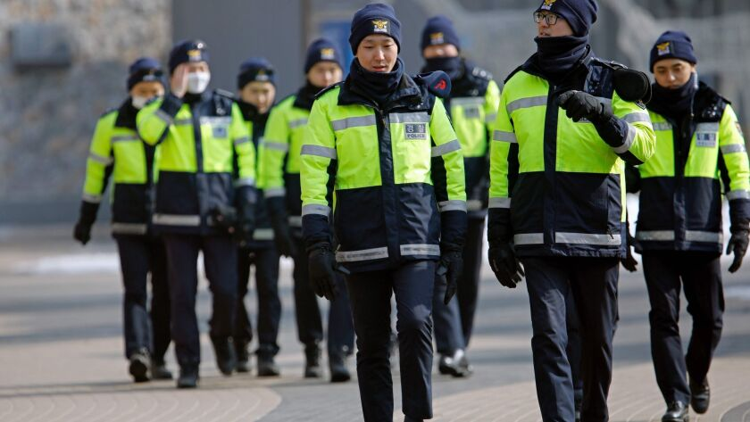 Police officers patrol a Winter Olympics venue on Feb. 10 in Pyeongchang, South Korea.