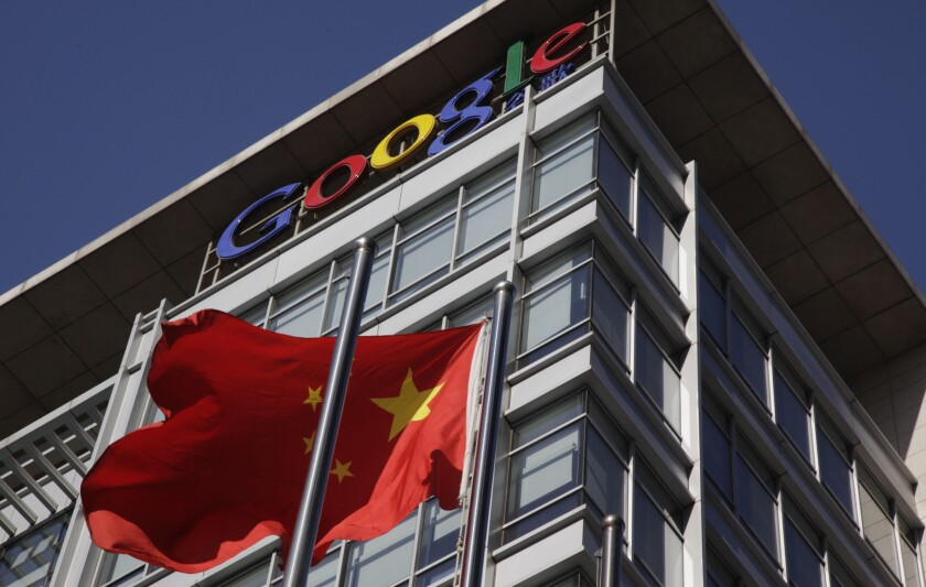 A Chinese flag flutters outside Google's China headquarters in Beijing in 2010. Access to Gmail, the company's email service, slowly returned to China Tuesday after an unexplained four-day outage.