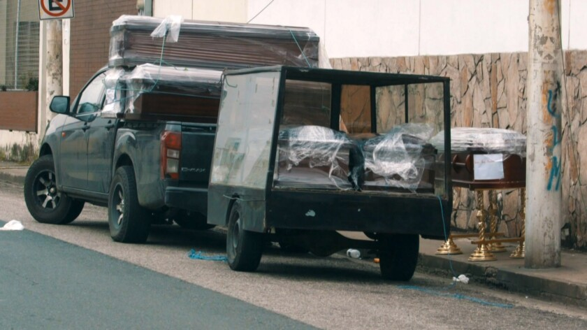 Wrapped coffins in a pickup truck