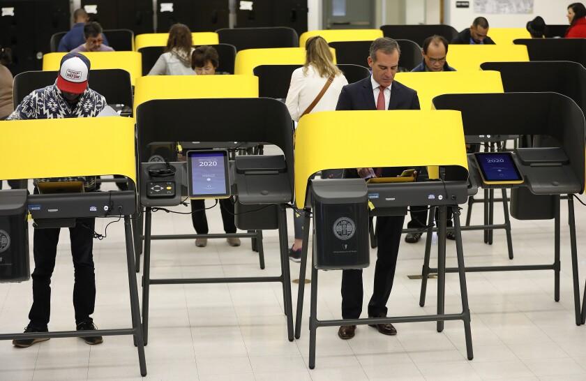 Los Angeles Mayor Eric Garcetti votes at Wilshire Park Elementary School on Tuesday morning