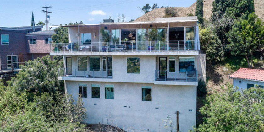 Comedians Scott Aukerman and Kulap Vilaysack list three-story home in Hollywood Hills