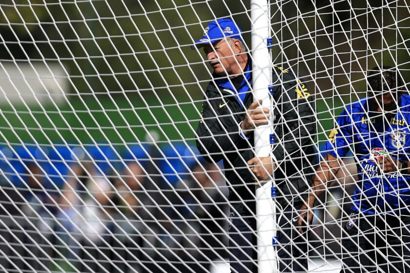 Brazil's coach Luiz Felipe Scolari, center, helps moving the goal during a practice session at the Granja Comary training center in Teresopolis, Brazil, Thursday, June 5, 2014. Brazil and Croatia competing in the opening match on June 12. (AP Photo/Hassan Ammar)