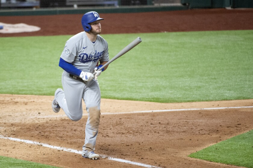The Dodgers' Max Muncy watches the flight of his three-run homer in the seventh inning against Texas on Aug. 29, 2020.