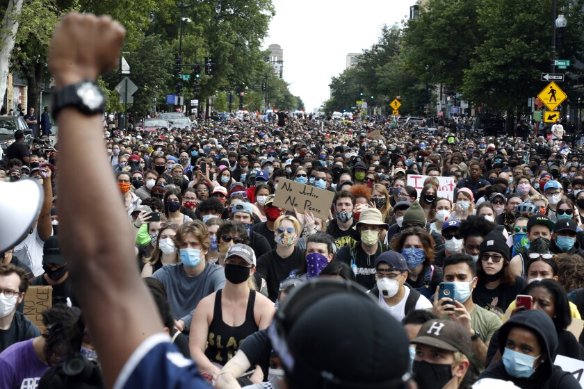 Demonstrators gather to protest the death of George Floyd, Tuesday, June 2, 2020, in Washington. Floyd died after being restrained by Minneapolis police officers. (AP Photo/Alex Brandon)