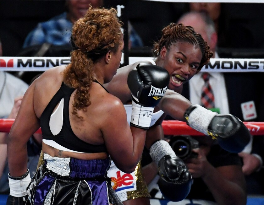 Claressa Shields throws an overhand right at Franchon Crews in the second round of their super-middleweight bout at T-Mobile Arena on Saturday.