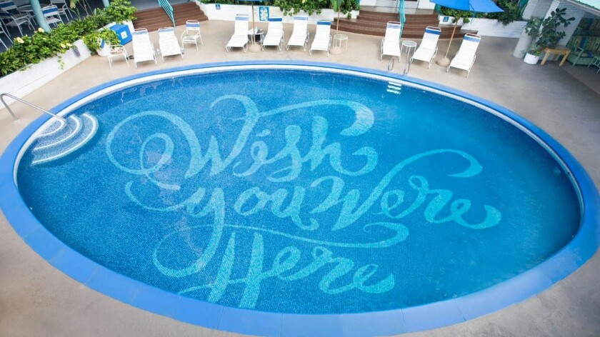 """The """"wish you were here"""" message at the bottom of the pool is reminiscent of vintage postcards. The Surfjack Hotel & Swim Club will welcome guests starting April 7."""