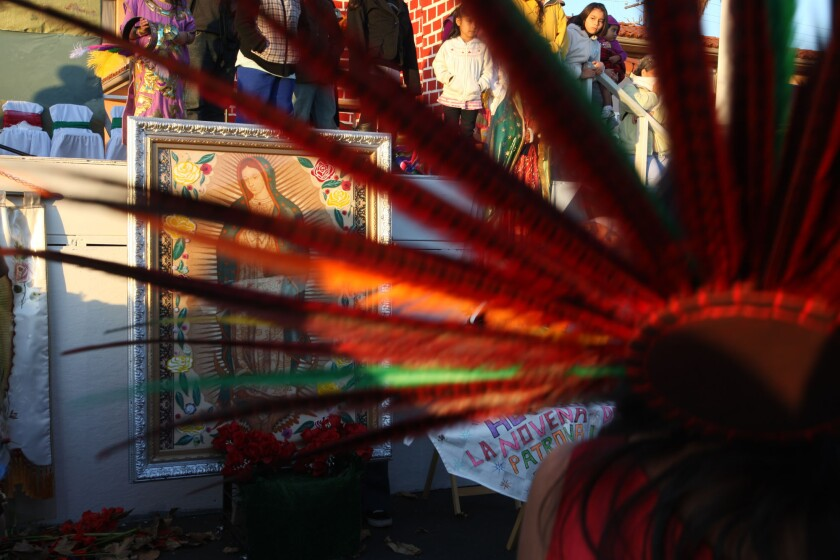 An Aztec dancer and an image of the Virgin of Guadalupe epitomize the cultural mix that overlies Mexico's stunning genetic diversity, revealed in a study published online Thursday in the journal Science.