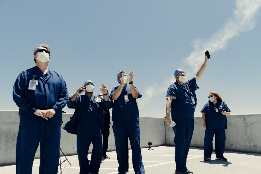Sharp Chula Vista Medical Center workers cheer the passing of the Air Force Thunderbirds demonstration team.