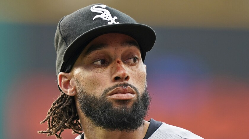 Chicago White Sox's Billy Hamilton runs to the dugout in the fourth inning of a baseball game against the Cleveland Indians, Tuesday, June 1, 2021, in Cleveland. Hamilton was injured in the face sliding into home plate in the second inning. (AP Photo/Tony Dejak)