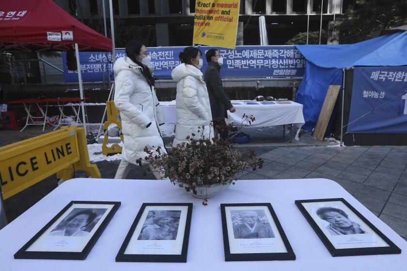 Portraits of late South Korean women forced to work as sex slaves are displayed near the Japanese Embassy in Seoul