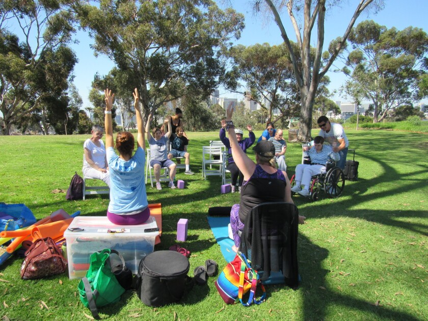 Jackie Gadd and Jo-San Arnold lead an adaptive yoga class at Balboa Park.