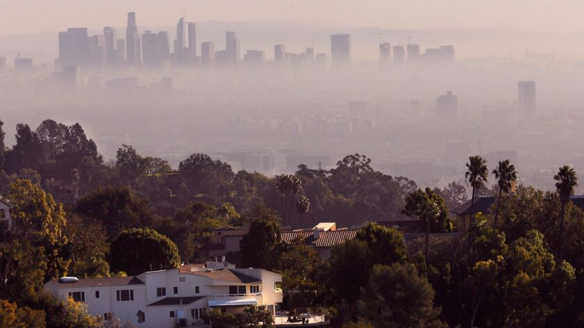 BEL AIR - DECEMBER 7, 2017 -- The downtown Los Angeles skyline peers through the smoke from the Skir